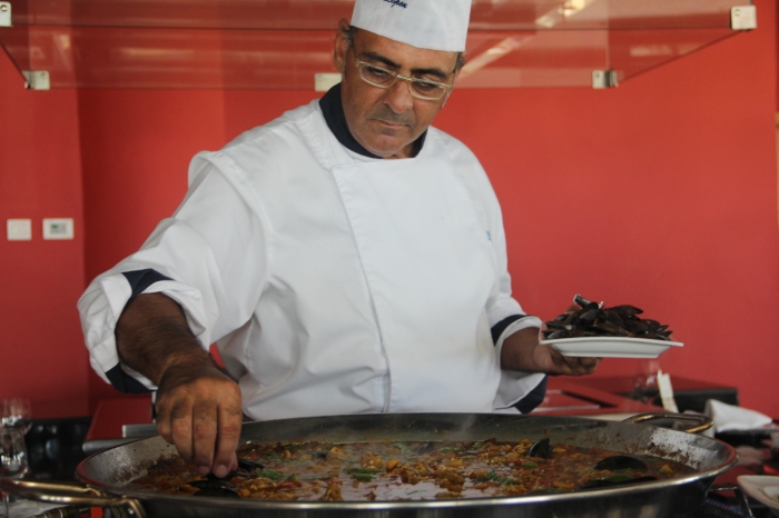 Preparing paella